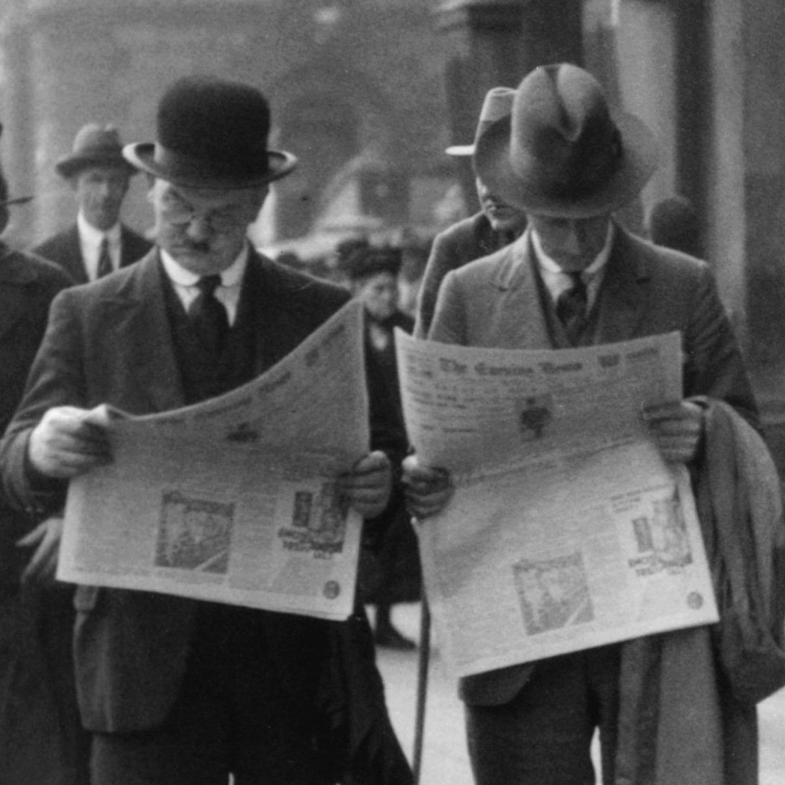 Men Reading Newspapers in London